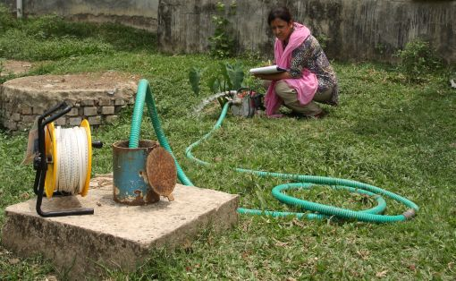 A TropHEE PhD candidate measuring the groundwater level during field work in Bangladesh © Suraiya Fatema